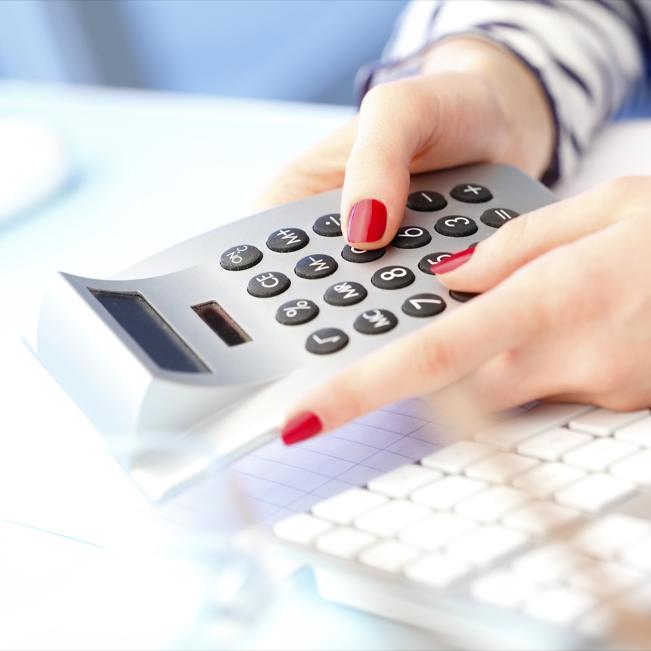 dental patient using calculator